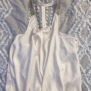 Silk blouse with rhinestone detail.